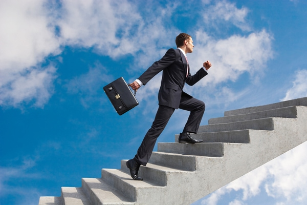 a picture of a man in a suit climbing a staircase into the sky.
