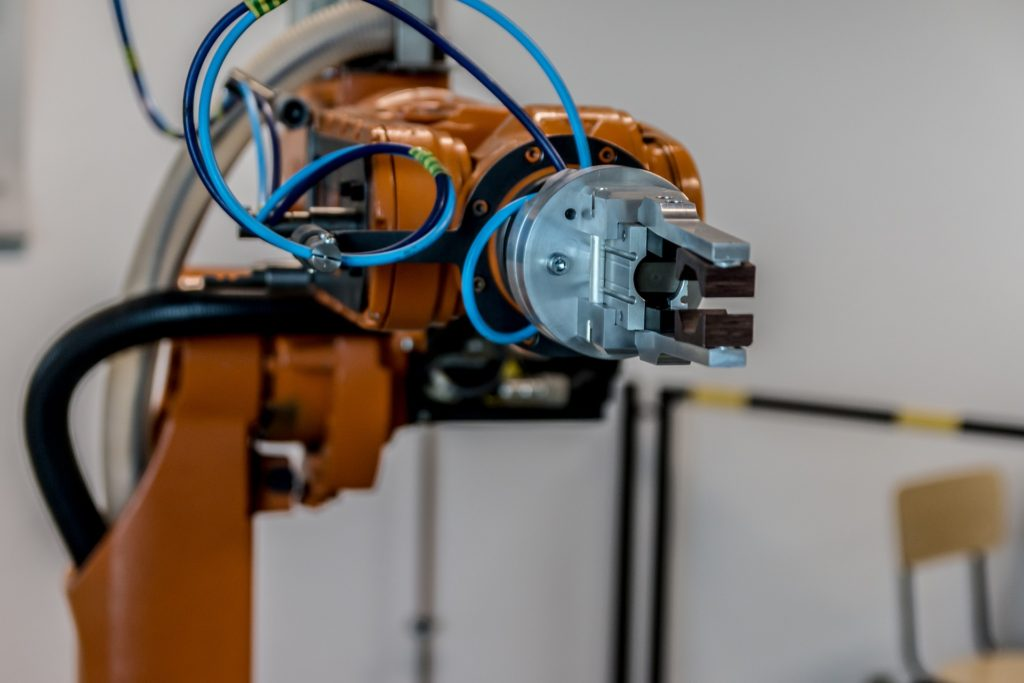 A picture of a manufacturing floor robot arm