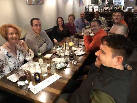 A picture of the Encompass Solutions team and Avalara reps sitting down for drinks and food at melt kitchen and bar in Greensboro, North Carolina.