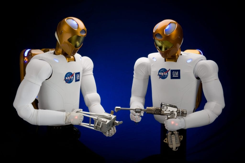A picture of Robonaut 2 holding different tools
