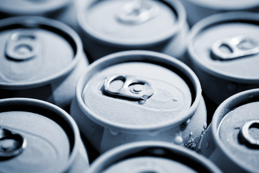 an image of canned beverages, signifying the aluminum industry, one industry affected by US-China Trade.