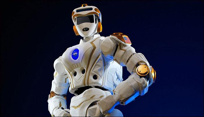 A picture of robonaut 5 with hands on hips.
