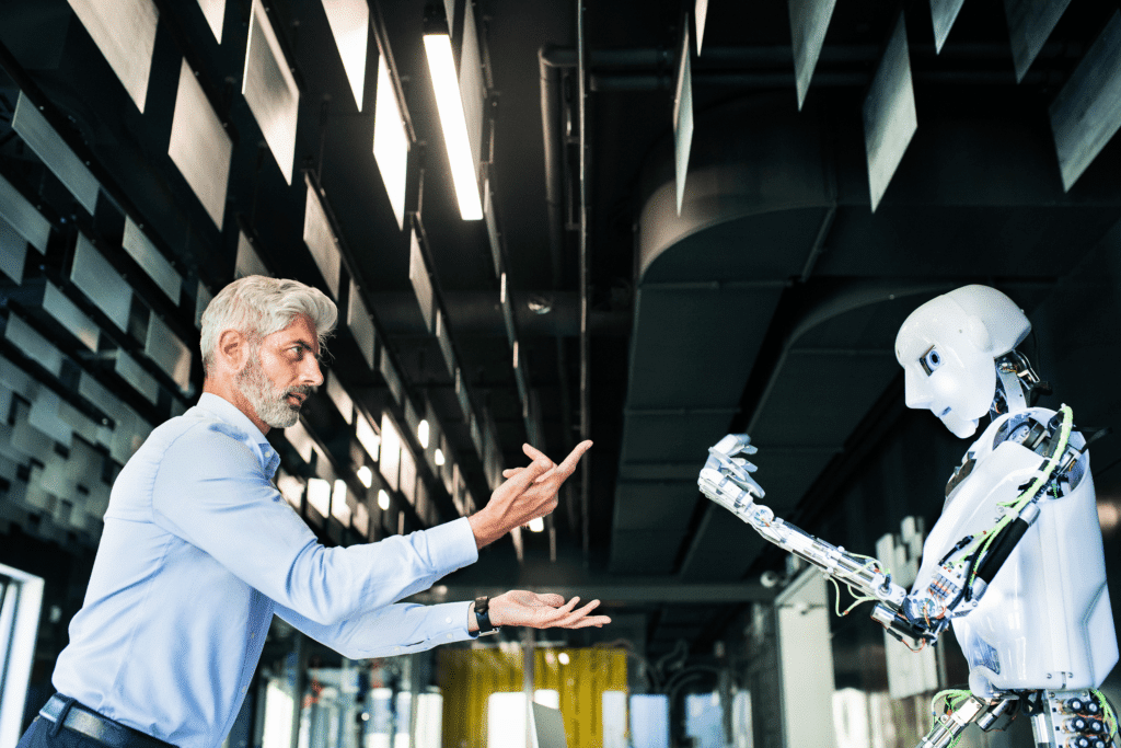A photograph of an executive or scientist commanding a humanoid robot. industry 5.0 new roles and jobs emerge.