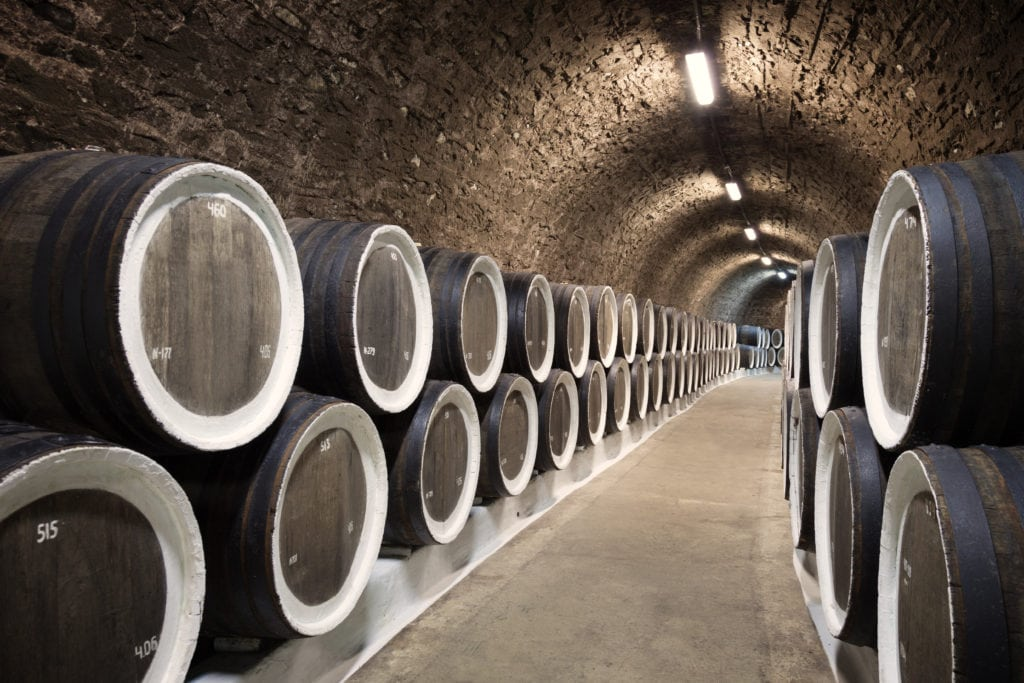 A picture of barrels in the wine cellar.
