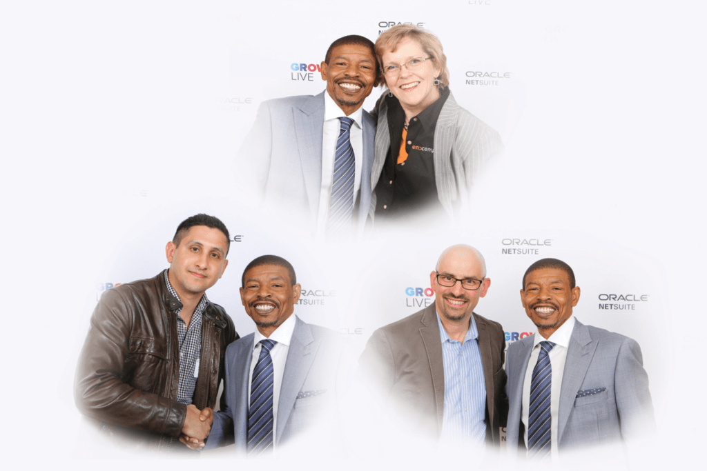 a photo of encompass team members with Muggsy Bogues.