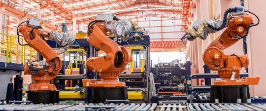 a picture of welding robots in a car manufacturer factory - the industry with the largest gains in August 2018 US Manufacturing.