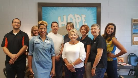 an image of volunteers during summer of service at the Salvation Army Of Greensboro center of hope.