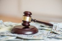 a picture of a gavel on a pile of money as the SCOTUS has ruled on Wayfair vs South Dakota.